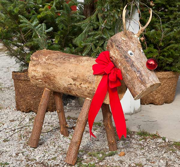 Hand-crafted wooden deer statue