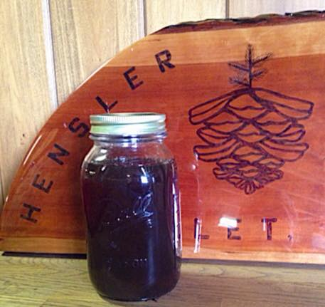 Quart of homemade maple syrup